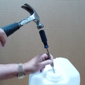Use Hammer and Screw Driver to Open the Bulk Lamp Oil